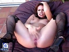 A sexy dark haired slut squirting while she cums