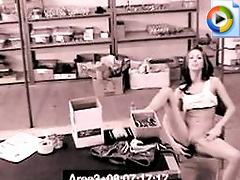 A security camera catches a girl getting herself off at work