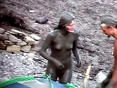 Tight nudist hottie caught on cam on a beach