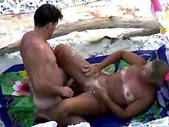 Sexy chick slyly filmed as she has terrific beach time