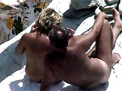 Young nude couple rejoice on a sunny beach